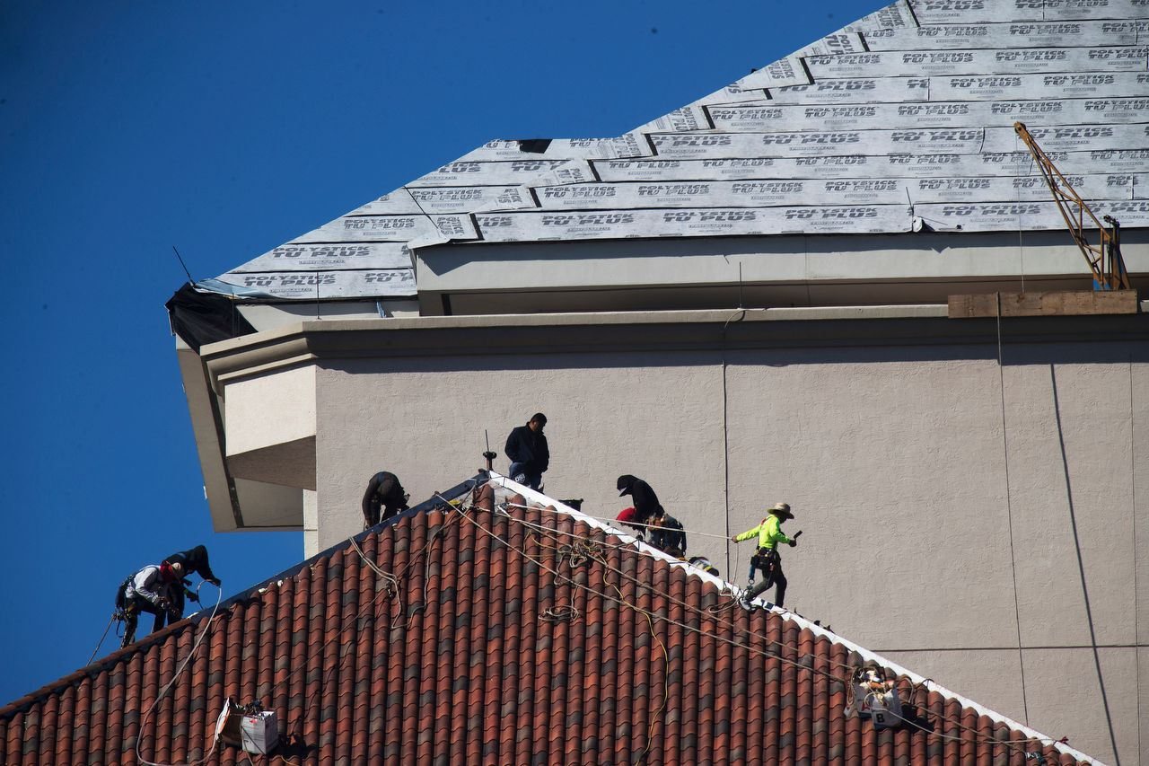Crowther Roofing installing roof on High Point Place in Fort Myers, Florida